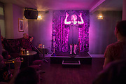 Sally Vate, local entertainer and drag queen, one of the best cabaret acts on the Brighton gay scene,  performing at The Queens Arms in Brighton, United Kingdom.