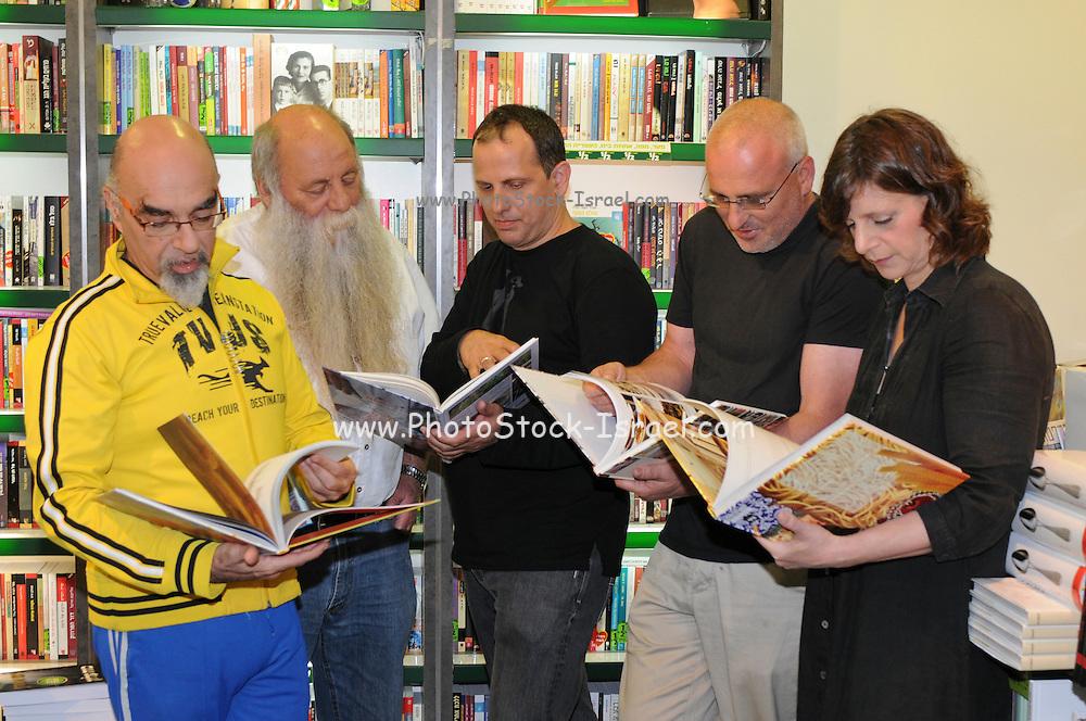 Five top Israeli chefs promote their latest cookbook in a book store (from left to right): Yisrael Aharoni, Uri Yarmias (AKA Uri Buri), Mane Shtrum, Erez Komarovsky, Orna Agmon
