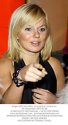 Singer GERI HALLIWELL at a party in London on 5th December 2002.PFZ 68