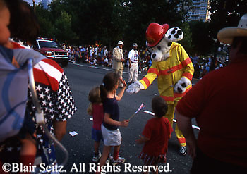July 4th Parade on Ben Franklin Boulevard, Children Candy, Fireman Dressed as Fire Dog, Philadelphia, PA