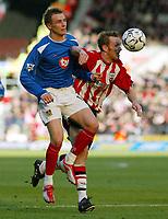 Photograph: Scott Heavey.<br />Southampton v Portsmouth. FA Barclaycard Premiership. 21/12/2003.<br />Brett Ormoerod beats Matthew Taylor to the ball