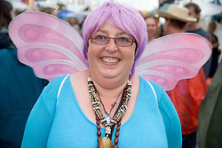 woman wearing fairy wings at the WOMAD (World of Music; Arts and Dance) Festival in reading; 2005,