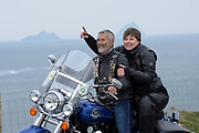4-5-2017: Husband and wife, Mark and Pauline Lucas from Cahersiveen, County Kerry pictured at Bray Head on Valentia Island along the Wild Atlantic Way and Skellig Ring in County Kerry on Thursday for the launch of Ireland BikeFest Killarney 2017. The three-day festival attracts motorcyclists in their tens of thousands from all over the world who will participate in a number of ride-outs on the Wild Atlantic Way as part of the festival programme. The fantastic scenery, touring routes, hospitality and free live entertainment make it one of the must attend and unique festivals of the year which takes place in Killarney this June Bank Holiday weekend.  <br /> Photo Don MacMonagle<br /> <br /> REPRO FREE PHOTO FROM IRELAND BIKEFEST<br /> Further info:: <br /> <br /> PRESS RELEASE: Get Your Motors Running for Ireland BikeFest <br />June 2nd to 5th 2017<br />We just can't wait to get on the road again for Ireland BikeFest 2017 which rumbles into Killarney across the June Bank Holiday weekend. Now in its eleventh year, Ireland BikeFest is an action-packed, three-day festival that attracts motorcyclists in their tens of thousands from all over the world to the Kingdom. The fantastic scenery, touring routes, hospitality and free entertainment make it one of the must attend festivals of the year.  <br /><br />Highlights for 2017 include daily ride outs along the Southwest section of the the Wild Atlantic Way - marshalled by Celtic Thunder Chapter Ireland and Gaelic Chapter Ireland, free Harley-Davidson® demo rides, Waterford and Dublin Harley-Davidson® Dealers, H.O.G.® Hospitality & Info, Jumpstart, Novelty Dog Show, the Custom Bike Show, Parade and lots of free live indoor and outdoor entertainment day and night. <br /><br />This year's line-up of entertainment is epic and with free entry to all Ireland BikeFest gigs there's simply no excuse not to go!  Three days, three stages and tons of free live music - there's the Outdoor Stage located at the heart of the Bike Village, t