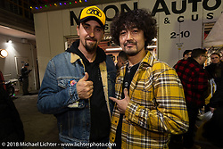 Custom bike builder Kaichiroh Kross Kurosu (R) of Cherry's Company and Fabrizio Caoduro or '70's Helmet at the Mooneyes Area-1 afterparty for overseas guests after their Yokohama show. Monday, December 3, 2018. Photography ©2018 Michael Lichter.