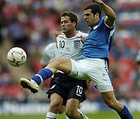 Photo: Jonathan Butler.<br /> England v Israel. UEFA European Championships Qualifying. 08/09/2007.<br /> Michael Owen of England is challenged by Tal Ben Haim of Israel.