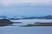 The Summer Isles, part of the Inner Hebrides, and the Outer Hebrides view from Altandhu on the West Coast of Scotland