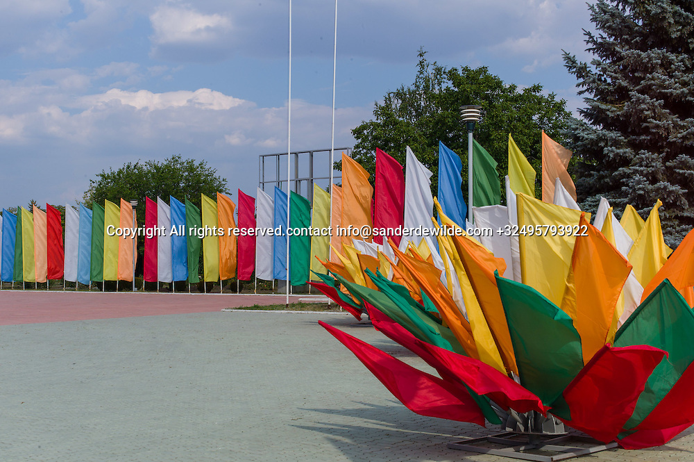 20150829  Moldova, Transnistria,Pridnestrovian Moldavian Republic (PMR) Dubushari.A square entirely decorated with flags in all colors, prepared for the 25th indepence day on the 2nd of September.