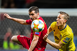 March 23, 2019 - Stockholm, SWEDEN - 190323 Alexandru Chipciu of Romania and Ludwig Augustinsson of Sweden during the UEFA Euro Qualifier football match between Sweden and Romania on March 23, 2019 in Stockholm. (Credit Image: © Andreas L Eriksson/Bildbyran via ZUMA Press)