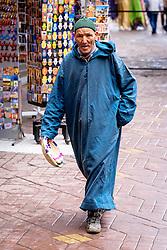 A man in traditional dress walks through the medina in Marrakech, Morocco, North Africa<br /> <br /> (c) Andrew Wilson | Edinburgh Elite media