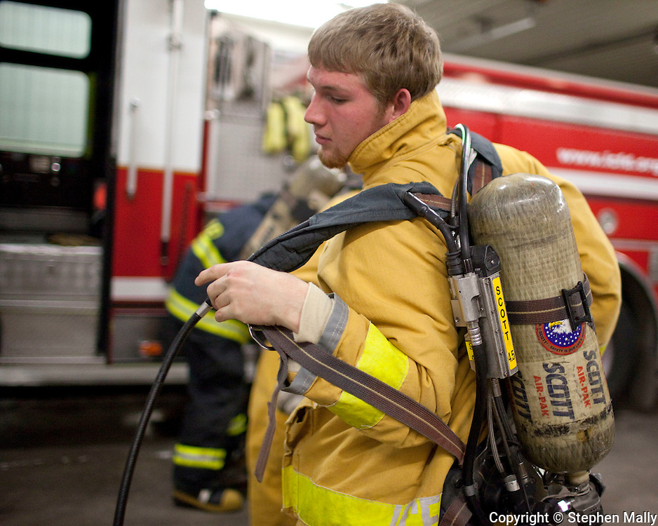 Tyler Zacek, 19 years old, Prairie senior, of Swisher puts on his air canister during a job shadow with the Iowa City Fire Department at the Iowa City Fire Department Training Center, 1001 South Clinton Street, in Iowa City on Thursday afternoon, November 18, 2010. The job shadow was organized by Workplace Learning Connection.