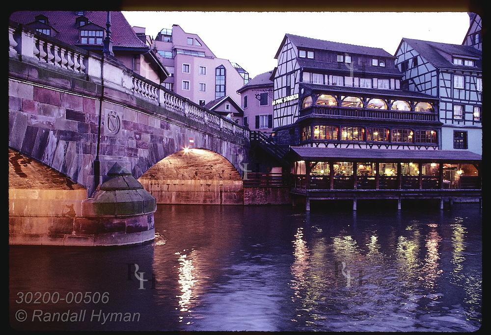 Dusk falls on restaurants & bridge in Quartier des Tanneurs area of Petite Francee; Strasbourg. Franc