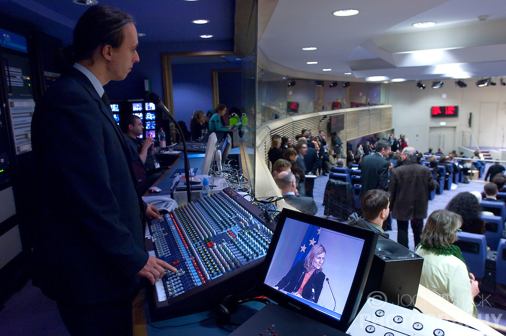 """BRUSSELS, BELGIUM - NOV-29-2006 - Maximilien Mansutti, """"le Register de Conference"""" coordinates all of the audio and video feeds in the control room for the translators booths at the EU Commission HQ press room. (PHOTO © JOCK FISTICK)<br />"""