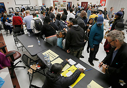 The wait time to vote at the Pittman Park precinct in Atlanta was reported to be three hours. Pizza and snacks were donated for the people waiting in line. Photo by Bob Andres/Atlanta Journal-Constitution/TNS/ABACAPRESS.COM