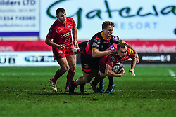 Scarlets' Ioan Nicholas is tackled by Dragons' Ellis Shipp<br /> <br /> Photographer Craig Thomas/Replay Images<br /> <br /> Guinness PRO14 Round 13 - Scarlets v Dragons - Friday 5th January 2018 - Parc Y Scarlets - Llanelli<br /> <br /> World Copyright © Replay Images . All rights reserved. info@replayimages.co.uk - http://replayimages.co.uk