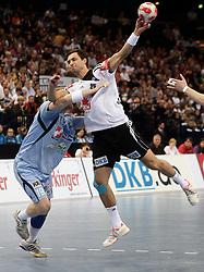 Handball: European Championship Qualification, Germany (GER) - Slovenia (SLO), Miha Zvizej (SLO), Michael Mueller (GER), www.hoch-zwei.net, copyright: SPORTIDA / HOCH ZWEI / Philipp Szyza