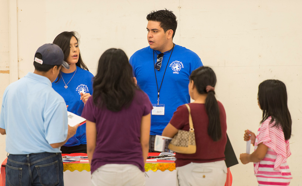 Representatives of Liberty High School recruit students during a School Choice Fair at Northwest Mall, April, 26, 2014.