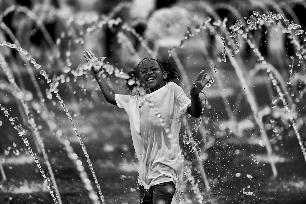 A little girl plays in the fountain of public square during the 2016 GOP convention at the Quicken Loans Arena in Cleveland, OH. The square was a focal point of many protesters, counter protesters and curious onlookers.