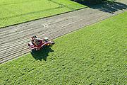 Nederland, Zeeland, Schouwen-Duiveland, 23-10-2013; omgeving Zierikzee, oogst van suikerbieten. De bieten worden met een speciale landbouwmachine gerooid. De banden laten patronen achter op de kale akker. <br /> Field with sugar beet. The beets are harvested with a special tractor.<br /> luchtfoto (toeslag op standaard tarieven);<br /> aerial photo (additional fee required);<br /> copyright foto/photo Siebe Swart.