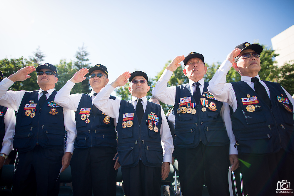 Members of the Korean War Veterans Association of Northern California salute during the National Anthem during the Memorial Day Ceremony at Milpitas City Hall's Veterans Plaza in Milpitas, California, on May 26, 2014. (Stan Olszewski/SOSKIphoto)
