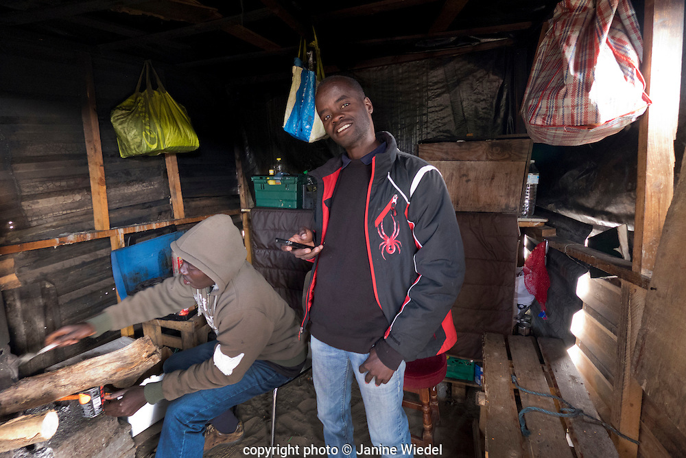 Young Ethiopian men in their makeshift home in the he Calais Jungle Refugee and Migrant Camp in France