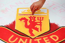 13th August 2017 - Premier League - Manchester United v West Ham United - A street artist paints the Man Utd club crest in chalk - Photo: Simon Stacpoole / Offside.