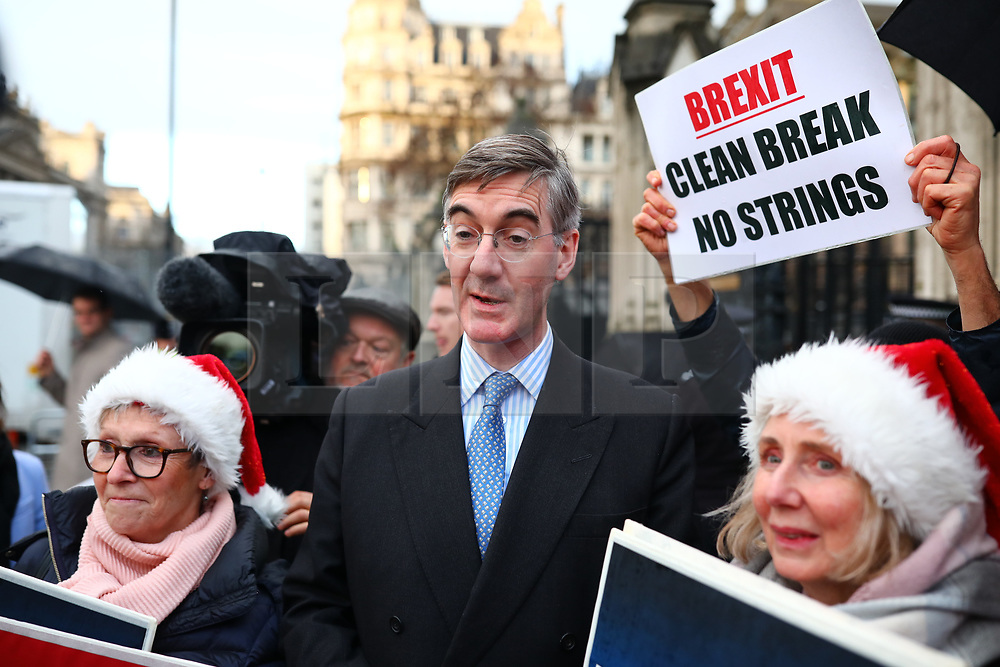 © Licensed to London News Pictures. 20/12/2019. London, UK. Leader of the Commons Jacob Rees-Mogg joins Brexit supporters outside Parliament as they celebrate MPs voting to pass the Withdrawal Agreement Bill. Photo credit: Rob Pinney/LNP