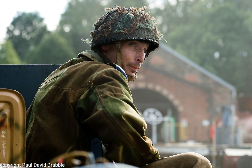 Renecator portraying a British Paratrooper from the 6th Airborne Division prepares for a battle reenactment at Elsecar 1940s Weekend <br /> 4 September 2010<br /> Images © Paul David Drabble