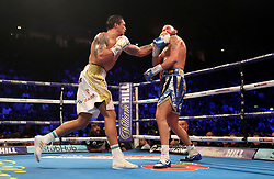 Tony Bellew (right) is knocked down in the eighth round by Oleksandr Usyk during their WBC, WBA, IBF, WBO & Ring Magazine Cruiserweight World Championship bout at Manchester Arena.