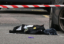 © Licensed to London News Pictures. 15/10/2015. London, UK. Medical equipment lies on the floor hera near Scriven Street in Hackney, east London where a male police officer was shot during an authorised firearms operation by the Trident gang crime unit of the Metropolitian Police.  A man has been arrested at the scene. Photo credit: Peter Macdiarmid/LNP