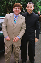 Left to right, MR DAVID FURNISH and singer ELTON JOHN, at a party in London on 30th June 1999.MTY 82