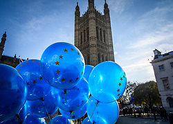 © Licensed to London News Pictures. 13/12/2018. Westminster, London, UK. EU balloons outside the Palace of Westminster a day after Teresa May survived a no confidence vote. Photo credit Guilhem Baker/LNP
