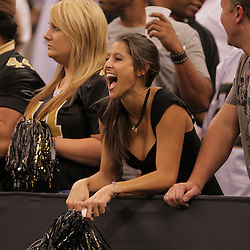 2008 October, 06: A New Orleans Saints fan screams from her seat during a week five regular season game between the Minnesota Vikings and the New Orleans Saints for Monday Night Football at the Louisiana Superdome in New Orleans, LA.