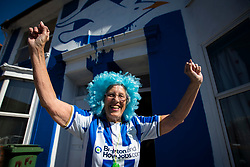 Brighton & Hove Albion fans stands with Brighton house painted in club colours in the city - Mandatory by-line: Jason Brown/JMP - 14/05/17 - FOOTBALL - Brighton and Hove Albion, Sky Bet Championship 2017 - Brighton and Hove Albion Promotion Parade