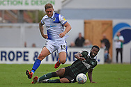 Joel Grant (16) of Plymouth Argyle tackles James Clarke (15) of Bristol Rovers during the EFL Sky Bet League 1 match between Bristol Rovers and Plymouth Argyle at the Memorial Stadium, Bristol, England on 8 September 2018.