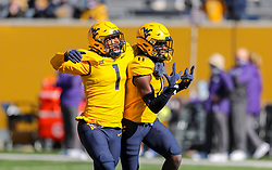 Oct 31, 2020; Morgantown, West Virginia, USA; West Virginia Mountaineers cornerback Nicktroy Fortune (11) celebrates with linebacker Tony Fields II (1) after an interception during the first quarter against the Kansas State Wildcats at Mountaineer Field at Milan Puskar Stadium. Mandatory Credit: Ben Queen-USA TODAY Sports