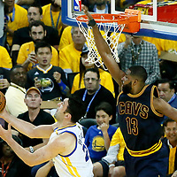 01 June 2017: Golden State Warriors center Zaza Pachulia (27) goes for the reverse layup past Cleveland Cavaliers center Tristan Thompson (13) during the Golden State Warriors 113-90 victory over the Cleveland Cavaliers, in game 1 of the 2017 NBA Finals, at the Oracle Arena, Oakland, California, USA.