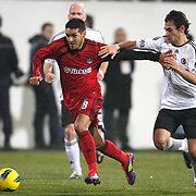 Besiktas's Veli Kavlak (R) and Gaziantepspor's Ismael Sosa (L) during their Turkish superleague soccer match Besiktas between Gaziantepspor at BJK Inonu Stadium in Istanbul Turkey on Tuesday, 05 January 2012. Photo by TURKPIX