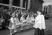 17/3/1966<br /> 3/17/1966<br /> 17 March 1966<br /> <br /> Rev. Father John MacMahon Blessing the Shamrocks before the parade