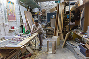 Mukesh, the in-house carpenter that makes much of the furniture and infrastructure at Champa Gali at work in his studio, New Delhi, India. Champa Gali is the latest and most intimate of Delhis urban creative villages.