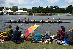 © London News Pictures. 29/06/2012.  Henley-on-Thames, UK.  Two women sleep underneath a colourful umbrella on day 3 of Henley Royal Regatta on the River Thames in Henley on Thames, Oxfordshire on June 29, 2012. Photo credit: Ben Cawthra/LNP