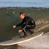 Surfers at Sandy Hook NJ take advantage of waves left over from a nor'easter storm a day earlier.