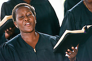 Graduate Mariam Daniel sings in the choir during the graduation of 21 pastors and seven deaconesses led by Bishop Emmanuel Makala on Saturday, March 14, 2015, at the Evangelical Lutheran Church in Tanzania – South-East of Lake Victoria Diocese's (ELCT-SELVD) Ebenezer Cathedral in Shinyanga, Tanzania.  LCMS Communications/Erik M. Lunsford