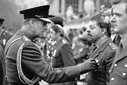The Duke of Edinburgh, as Senior Colonel of the Household Division, pins the South Atlantic Medal on Guardsman Simon Weston, from Gwent, at Buckingham Palace in London. Guardsman Weston was wounded during the attack on the Sir Galahad during the Falklands War.