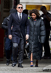 """© Licensed to London News Pictures. 30/05/2015. London, UK. . Filming for the new James Bond film """"Spector"""" with Daniel Craig (left) and Naomie Harris (right) at the courtyard of the UK Government Treasury building in Westminster, London . Photo credit: Ben Cawthra/LNP"""