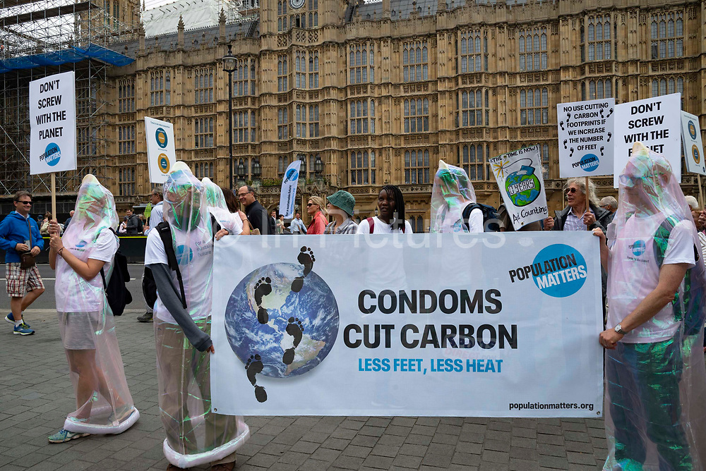 Demonstrators dressed as condoms at a climate change protest in Westminster, Central London, United Kingdom on 26th June 2019. Organisers of the Time is Now mass lobby demand politicians end the UKs contribution to climate change.