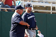 CARY, NC - FEBRUARY 23: Monmouth head coach Dean Ehehalt (left) with assistant Chris Collazo (5). The Monmouth University Hawks played the Saint John's University Red Storm on February 23, 2018 on Field 2 at the USA Baseball National Training Complex in Cary, NC in a Division I College Baseball game. St John's won the game 3-0.