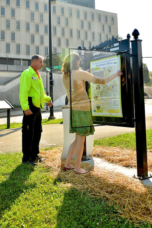Signs being installed along the Ohio & Erie Canal Towpath Trail in Akron.
