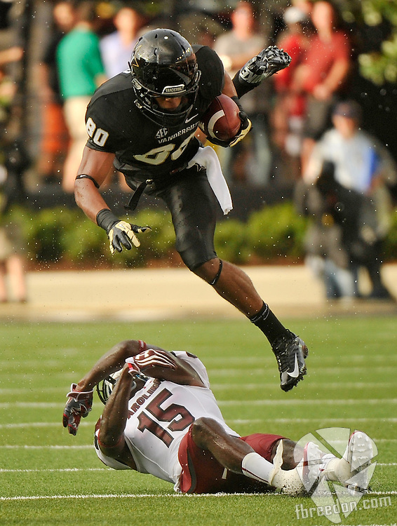 NASHVILLE, TN - AUGUST 30:  Chris Boyd #80 of the Vanderbilt Commodores jumps over Jimmy Legree #15 of the South Carolina Gamecocks at Vanderbilt Stadium on August 30, 2012 in Nashville, Tennessee.  (Photo by Frederick Breedon/Getty Images) *** Local Caption *** Jimmy Legree; Chris Boyd