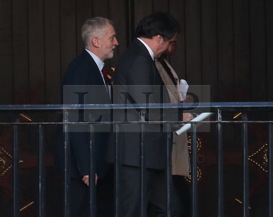 © Licensed to London News Pictures. 05/01/2016. London, UK. Labour Party Leader Jeremy Corbyn (L) walks to parliament after anouncing changes to his shadow cabinet. Photo credit: Peter Macdiarmid/LNP