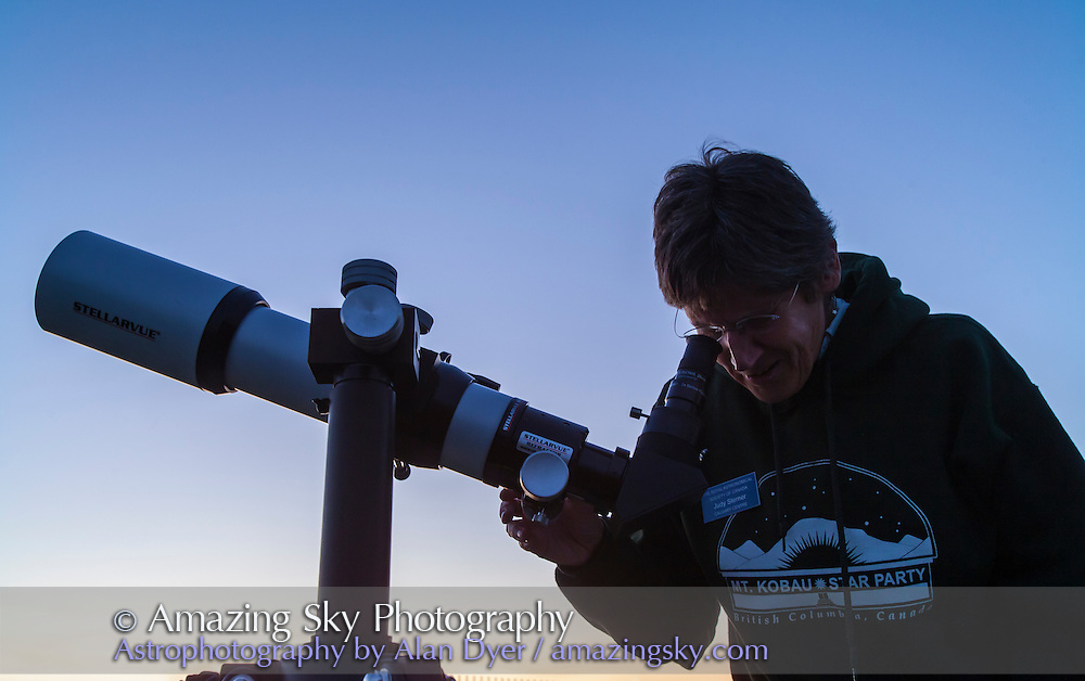 Judy gets her refractor telescope ready for early evening views of Saturn. <br /> <br /> Public and local astronomers gathered at the Rothney Astrophysical Observatory on July 21, 2012 for one of the annual Milky Way Nights presented by the RAO. From 10 pm to 2 am several hundred people stargazed under clear skies, enjoyed the naked eye views of the Milky Way and telescopic views of deep-sky objects such as nebulas and galaxies. Volunteers from the Calgary Centre of the Royal Astronomical Society of Canada and staff from TELUS Spark helped present the stars to the public.
